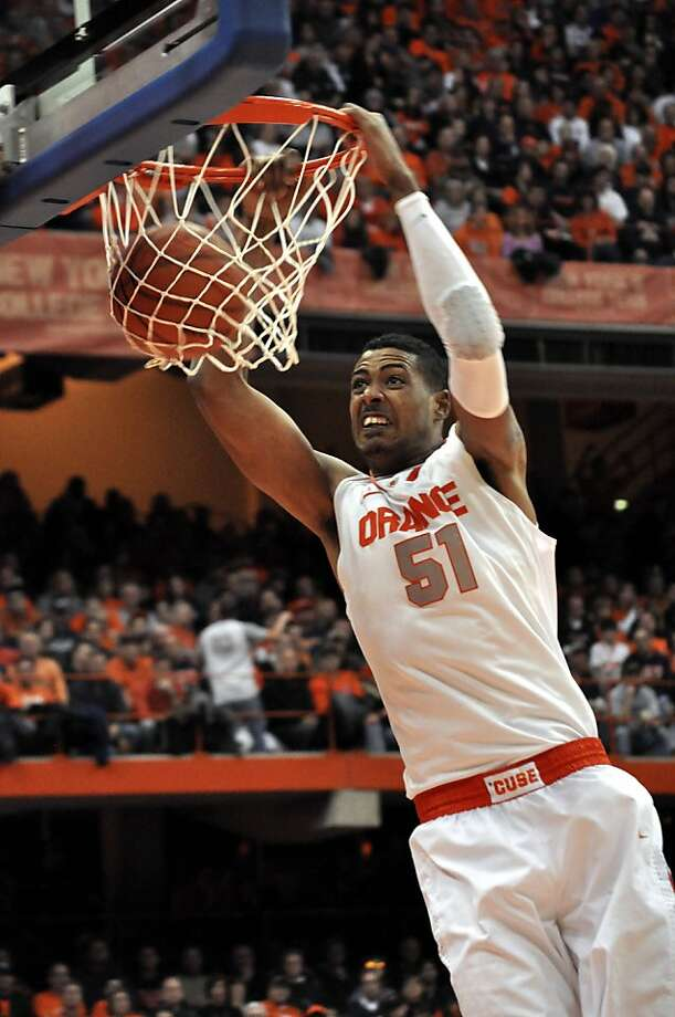 FILE - In this Jan. 14, 2012, file photo, Syracuse's Fab Melo dunks against Providence during the second half of an NCAA college basketball game in Syracuse, N.Y. Melo did not travel with the team to Pittsburgh and the university says he won't take part in the NCAA tournament due to an eligibility issue.  The school would not elaborate.  (AP Photo/Kevin Rivoli, File) Photo: Kevin Rivoli, Associated Press