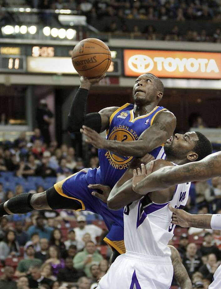 Golden State Warriors guard Nate Robinson, left, goes to the basket against Sacramento Kings guard Tyreke Evans during the first quarter in an NBA basketball game in Sacramento, Calif., Tuesday, March 13, 2012. Photo: Rich Pedroncelli, Associated Press