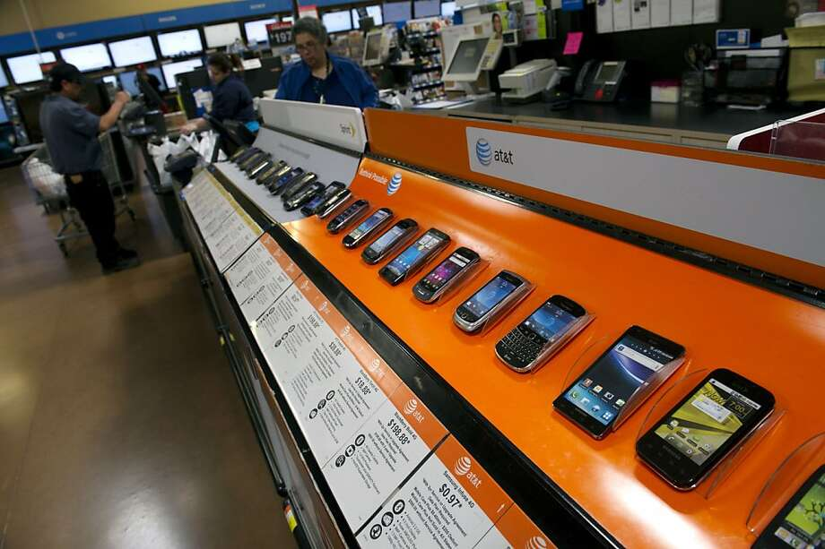 Various smartphone devices are displayed for sale at a Wal-Mart Stores Inc. location in American Canyon, California, U.S., on Thursday, Feb. 16, 2012. Wal-Mart Stores Inc. is scheduled to release fourth-quarter earnings on Feb. 21. Photographer: David Paul Morris/Bloomberg Photo: David Paul Morris, Bloomberg