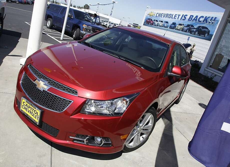 FILE - In this Aug. 30, 2011 file photo a 2011 Chevrolet Cruze is featured at a car dealership in San Jose, Calif. General Motors Co. said Thursday, Feb. 16, 2012, it made more money in 2011 than any year in its history.  (AP Photo/Paul Sakuma) Photo: Paul Sakuma, Associated Press