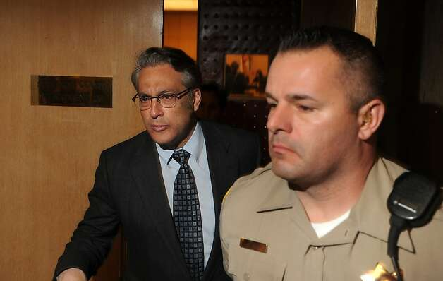 San Francisco Sheriff Ross Mirkarimi leaves court after pleading guilty to a misdemeanor charge of false imprisonment on Monday, March 12, 2012, in San Francisco. In exchange for the plea, prosecutors dropped a domestic violence charge and two other misdemeanor counts stemming from a New Year's Eve incident at Mirkarimi's home. Photo: Noah Berger, Special To The Chronicle