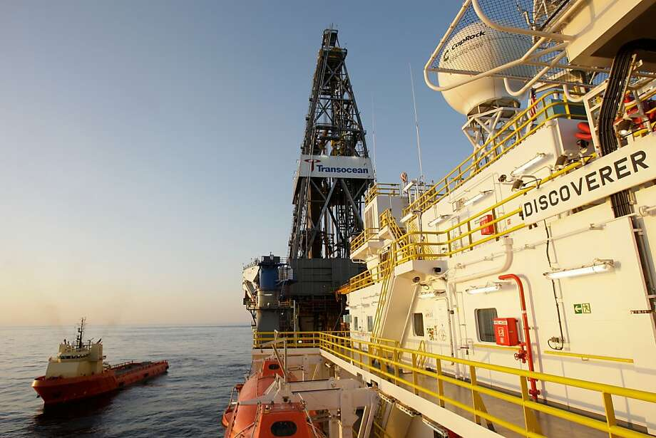 In this March 30, 2010 photo, a supply vessel passes next to the ultra-deepwater drillship Discoverer Inspiration in the Gulf of Mexico. Nearly as big as an aircraft carrier, the Discoverer Inspiration is built to operate in waters up to 12,000 feet deepand drill wells at a total depth of 40,000 feet. Chevron is drilling an exploration well into Moccasin Prospect on Transocean's Discoverer Inspiration in the U.S. Gulf of Mexico about 240 nautical miles from Leesville, La. Photo: Melissa Phillip, AP