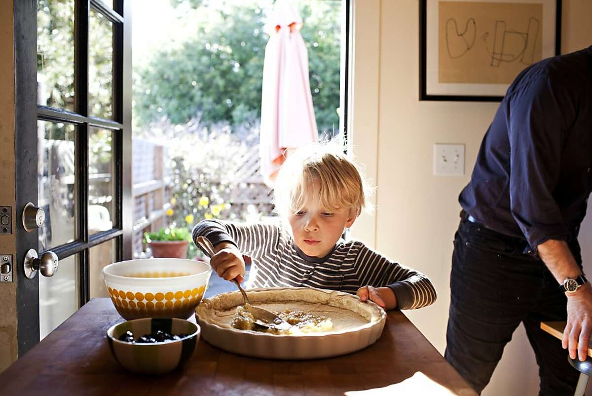 Dashiell Ross, 4, fills a tart with caramelized onions while his mother Phyllis Grant, not pictured, photographs him as part of a cooking segment for her blog, dashandbella.blogspot.com, at their home in Berkley, Calif., March 6, 2012. Jason Henry/Special to The Chronicle