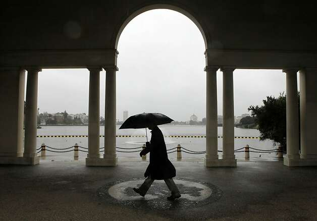 A man braces himself against the wind as he walks around Lake Merritt in Oakland. The first in a series of rain storms hit the Bay Area Tuesday March 13, 2012 bring mush needed rain as well as snow to the Sierra's. Photo: Lance Iversen, The Chronicle