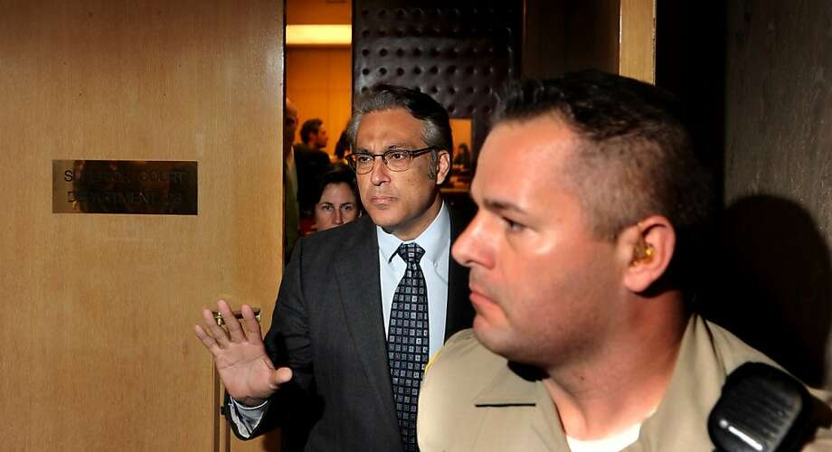 Flanked by a deputy, San Francisco Sheriff Ross Mirkarimi, left, leaves court after pleading guilty to a misdemeanor charge of false imprisonment on Monday, March 12, 2012, in San Francisco. In exchange for the plea, prosecutors dropped a domestic violence charge and two other misdemeanor counts stemming from a New Year's Eve incident involving Mirkarimi and his wife Eliana Lopez. (AP Photo/San Francisco Chronicle, Noah Berger) Photo: Noah Berger, Associated Press
