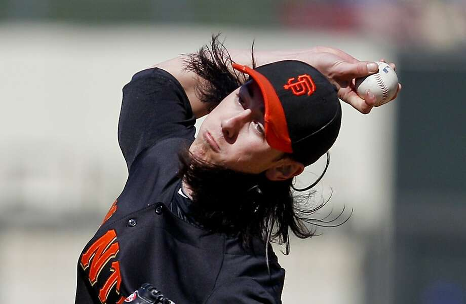 **CORRECTS TO MONDAY MARCH 12**San Francisco Giants starting pitcher Tim Lincecum pitches during the third inning against the Kansas City Royals in a spring training baseball game Monday, March 12, 2012 in Surprise, Ariz. (AP Photo/Lenny Ignelzi) Photo: Lenny Ignelzi, Associated Press