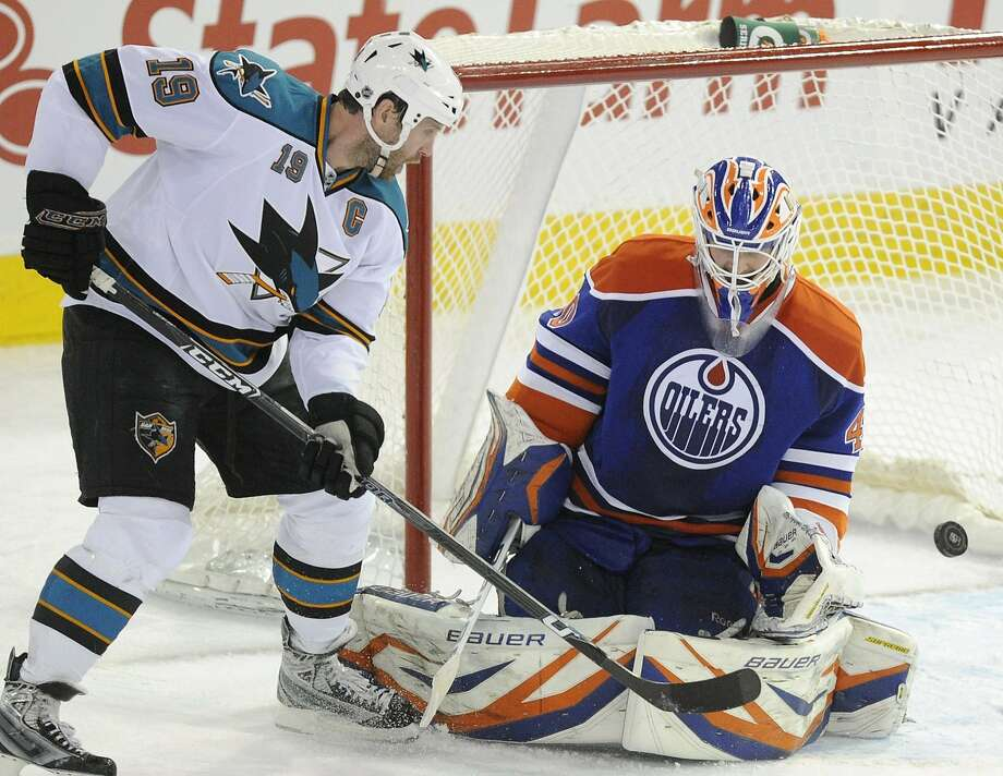 Joe Thornton, who scored for the Sharks in the second period, takes a shot against Oilers goalie Devan Dubnyk in the third. Photo: John Ulan, Associated Press