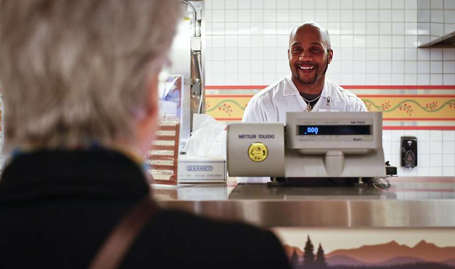 Bobby Thomas, seen on the job as a butcher at Andronico's in San Francisco, Calif., on Tuesday, March 6, 2012, is a charismatic man who also helps raise funds for Koret Family House. Photo: Russell Yip, The Chronicle