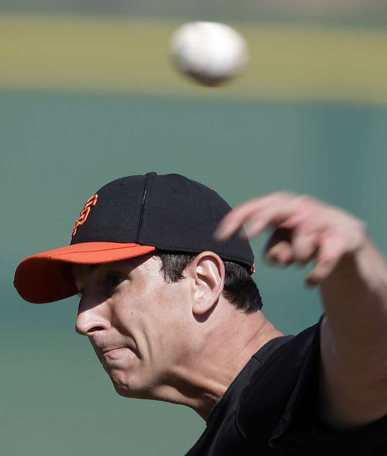 San Francisco Giants' Eric Surkamp throws during a spring training baseball workout on Sunday, Feb. 26, 2012, in Scottsdale, Ariz. (AP Photo/Darron Cummings) Photo: Darron Cummings, Associated Press