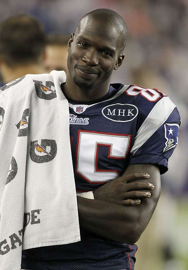 FILE - In this Sept. 1, 2011 file photo, New England Patriots' wide receiver Chad Ochocinco stands on the sideline during the fourth quarter of a preseason NFL game against the New York Giants at Gillette Stadium in Foxborough, Mass. Fans have turned Twitter into a digital version of the autograph session, asking _ sometimes begging or pleading _ stars from every sport for a shoutout. Oh, sure, some requests are designed to raise the profile of a charitable cause. But most fans are simply looking for a little love from their favorite athletes like Ochocinco. (AP Photo/Stew Milne, File) Photo: Stew Milne, Associated Press