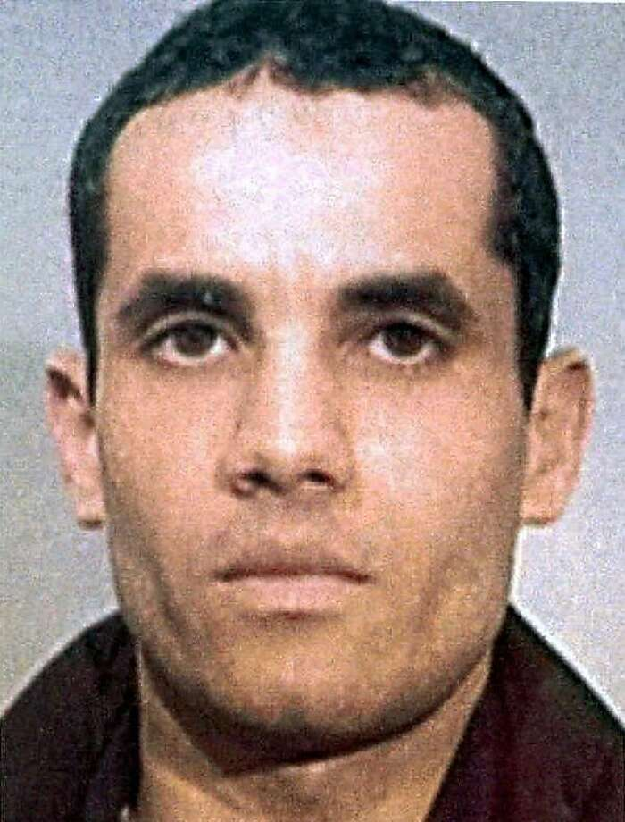 "UNDATED FILE PHOTO-In this undated police handout file photo, Algerian Ahmed Ressam is pictured.  Ressam was arrested near the U.S.-Canadian border and convicted of plotting to bomb Los Angeles International Airport at the turn of the millennium. A federal appeals court has overturned the 22-year sentence for Ressam, the convicted ""millennium bomber"", calling it unreasonably lenient. The 9th U.S. Circuit Court of Appeal ruled 7-4 in favor of the government's appeal in a decision released Monday March 12,2012. (AP Photo/Canadian Press, Police Handout via Le Journal de Montreal,File) Photo: Anonymous, Associated Press"