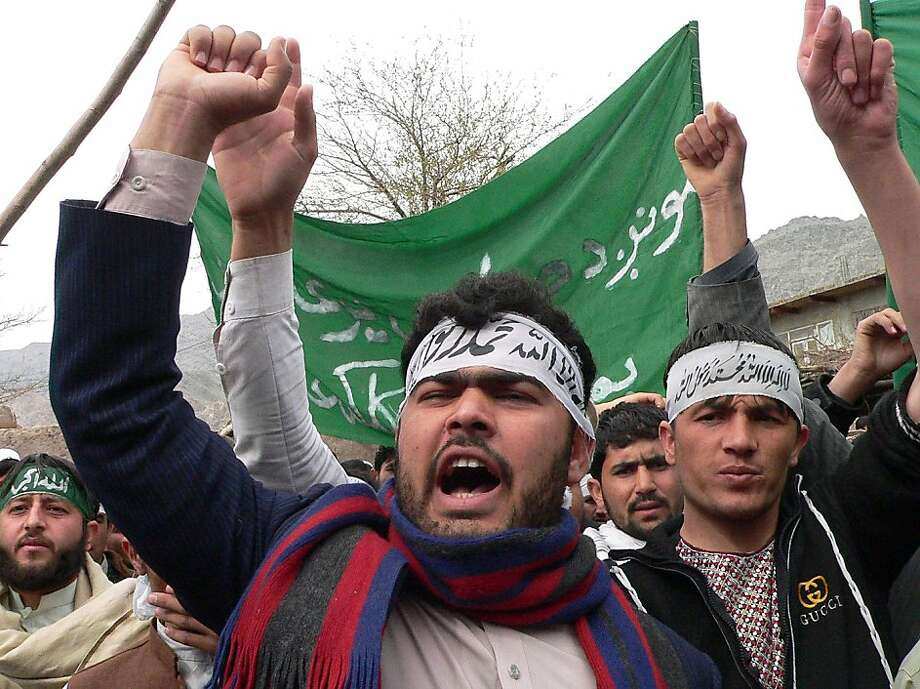 "Afghan protestors shout anti-US slogans during a demonstration in Jalalabad, capital of Nangarhar province on March 13, 2012. Hundreds of university students took to the streets in Afghanistan's eastern city of Jalalabad to protest a rampage by a US soldier who killed 16 villagers, witnesses said. In the first street demonstrations since the mass killings on March 11, about 400 protesters shouted ""Death to America -- Death to (US President Barack) Obama"", and called for the soldier to be tried in public in Afghanistan. AFP PHOTO/ Noorullah Shirzada (Photo credit should read Noorullah Shirzada/AFP/Getty Images) Photo: Noorullah Shirzada, AFP/Getty Images"