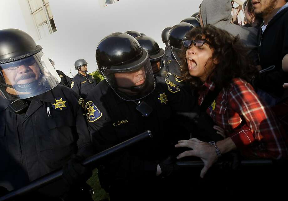 Police pushed back with their batons trying to find a way into the small tent site. After a peaceful rally and march, protesters voted to form an Occupy Cal group and set up tents near Sproul Hall.  Police from the campus and Alameda County sheriffs broke through their human barricade and took the tents Wednesday November 9, 2011. Photo: Brant Ward, The Chronicle