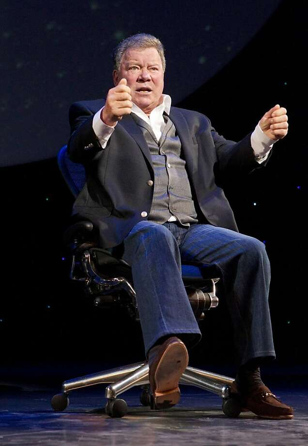 "In this theater image released by Boneau/Bryan-Brown, William Shatner performs in his one-man show, ""Shatner's World: We Just Live In It,"" at Broadway's Music Box Theatre in New York.  (AP Photo/Boneau/Bryan-Brown, Joan Marcus) Photo: Joan Marcus, Associated Press"