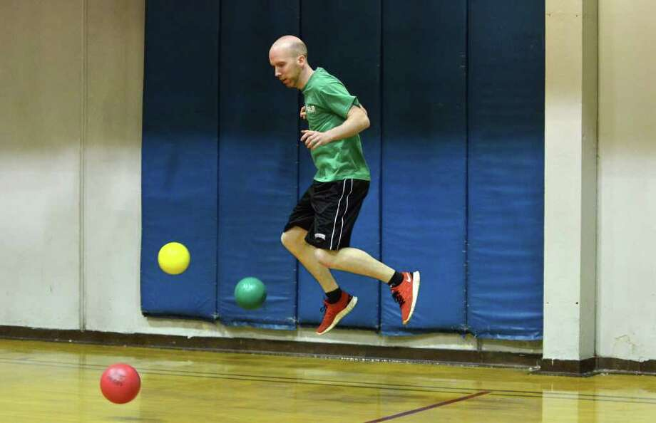 Kevin Cunningham, of Stamford, jumps out of harms way during dodgeball at the Stamford YMCA on Tuesday, Mar. 13, 2012. Photo: Amy Mortensen