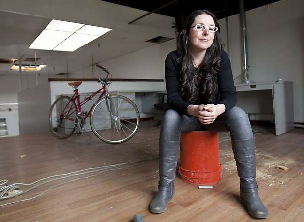 Dafna Kory, owner of Inna Jams, sits on a bucket in her under-construction kitchen in Emeryville on Saturday. Kory will be leading a workshop for Food Craft Institute, an organization launching in April that will offer master classes to people who wish to start food artisan business at it's kitchen at Jack London Square. Photo: Kevin Johnson, The Chronicle