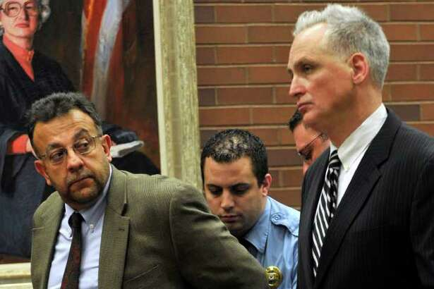 Joseph DaSilva Jr. is handcuffed by a court officer as DaSilva's attorney, Eugene Riccio, listens to the judge speak during the sentencing hearing at state Superior Court in Danbury on Wednesday, March 14, 2012. DaSilva was sentenced to five years in prison, suspended after serving 18 months, followed by five years probation. DaSilva pled guilty to criminally negligent homicide and second- and third-degree assault.