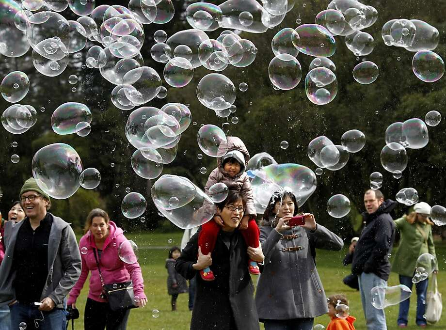 Dozens of bubbles drifted toward a crowd delighting both parents and children alike. Mike L. Miller has two great loves: hiking and making  bubbles.  He entertained a small crowd Sunday March 11, 2012 at Sharon Meadow in Golden Gate Park with a demonstration of his bubble making abilities. Photo: Brant Ward, The Chronicle