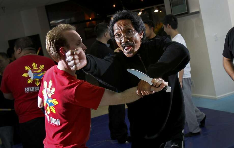 Grand Master Robert Castro, right, works with Brian Miller during training for ESKABO Daan, a new Filipino martial arts form,  in San Francisco, Calif., Tuesday, January 31, 2012.  Castro is the creator and founder of the discipline. Photo: Sarah Rice, Special To The Chronicle