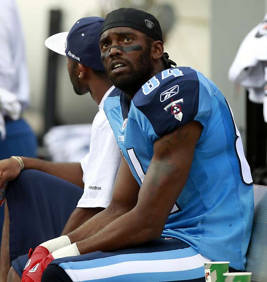 In this file photo taken Nov. 14, 2010, Tennessee Titans' Randy Moss sits on the bench during an NFL football game against the Miami Dolphins in Miami. New Orleans Saints general manager Mickey Loomis said the club has held a workout with the veteran receiver, who is trying to make a comeback after spending a year out of football. (AP Photo/Alan Diaz, file) Photo: Alan Diaz, Associated Press