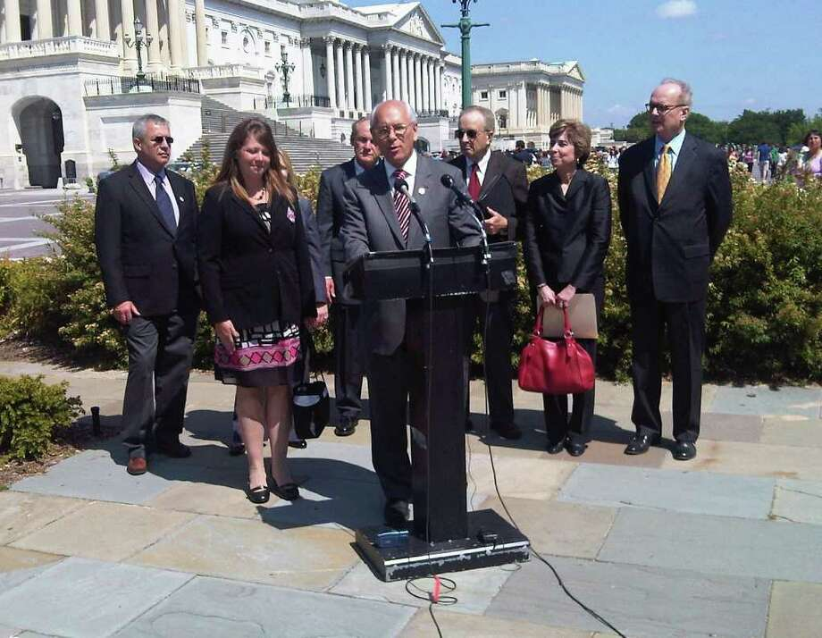 U.S. Rep. Paul Tonko holds a press conference in Washington D.C. To reintroduce legislation motivated by the death of Cobleskill trucker, Jason Rivenburg, Wednesday May 11, 2011. Hope Rivenburg, the widow of Jason Rivenburg, for whom the trucker-parking law is named, is pictured left. (Hearst Washington Bureau/Times Union archive)