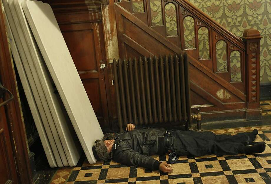 A man who didn't find room in the pews, slept on the floor at the rear of the church. The Gubbio project at St. Boniface Church in San Francisco, Calif. has seen an increase in homeless since the Transbay Terminal was demolished and the sit/lie ordinance enforced. The Gubbio project allows people to sit and sleep in the pews of the Tenderloin Catholic church from 6 a.m. til 1 p.m. Photo: Brant Ward, The Chronicle