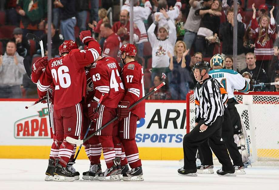 The Phoenix Coyotes celebrate after Mikkel Boedker #89 scored a second period goal past goaltender Antti Niemi #31 of the San Jose Sharks during the NHL game at Jobing.com Arena on March 10, 2012 in Glendale, Arizona. Photo: Christian Petersen, Getty Images