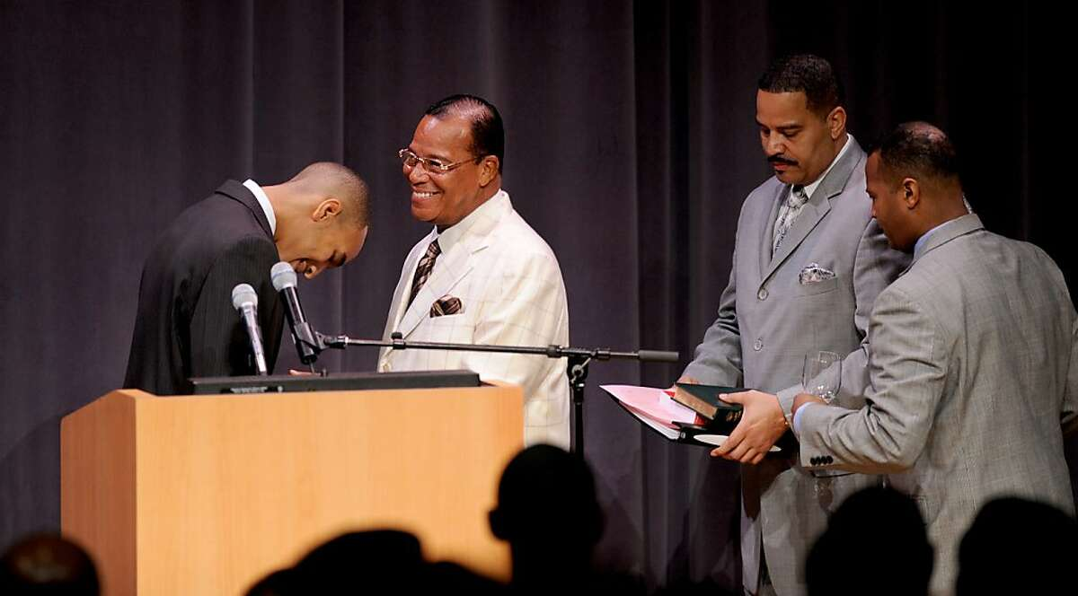 Salih Muhammed, chair of the University of California, Berkeley's Black Student Union, bows to Nation of Islam Minister Louis Farrakhan as he arrives to address the Afrikan Black Coalition Conference on Saturday, March 10, 2012, in Berkeley, Calif.