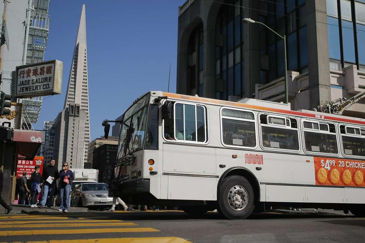 The 30 Stockton MUNI line drives up Stockton and Washington Streets in San Francisco, Calif. on Friday, March 9, 2012.