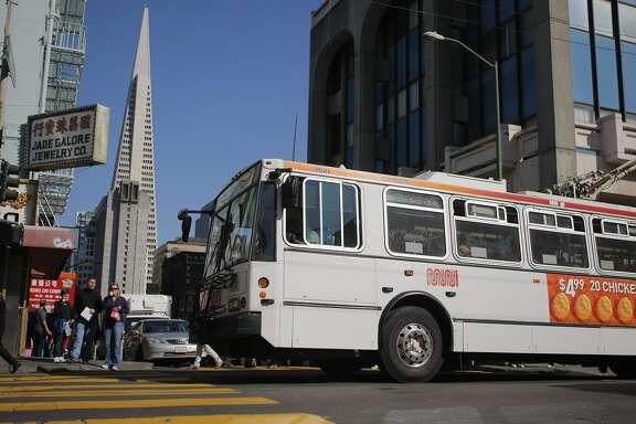The 30 Stockton MUNI line drives up Stockton and Washington Streets in San Francisco, Calif. on Friday, March 9, 2012.