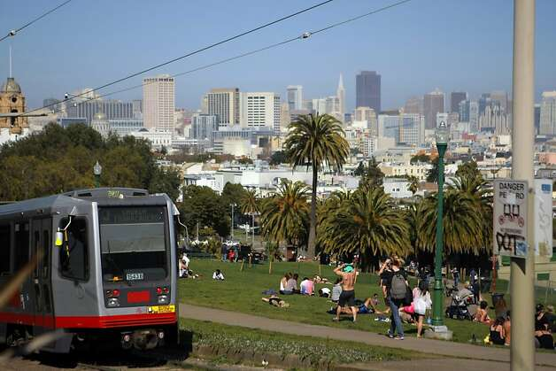 The J Church MUNI line drives by the Dolores Park in San Francisco, Calif. on Friday, March 9, 2012. Photo: Erik Verduzco, The Chronicle