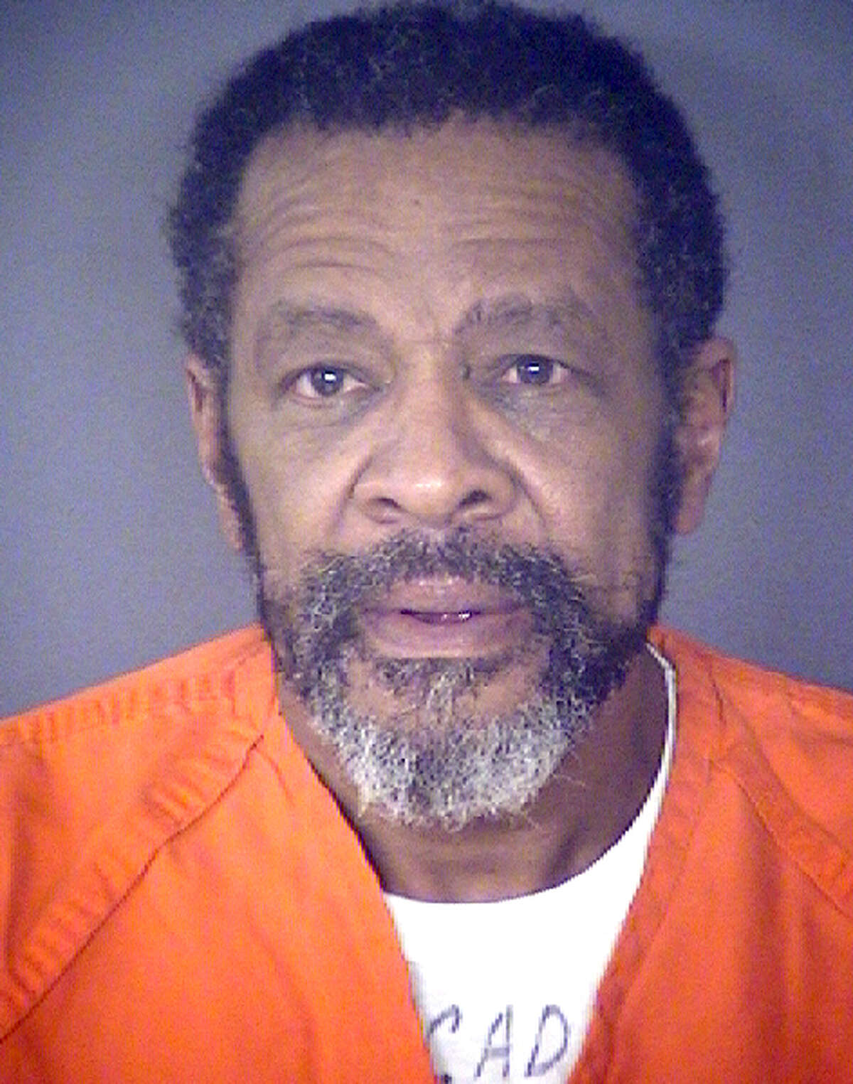 """Norman James Watson, also known as Andre James Johnson, 59, was arrested Tuesday and charged with two counts of theft of an elderly person in a scam police called a """"pigeon drop"""" gone awry."""