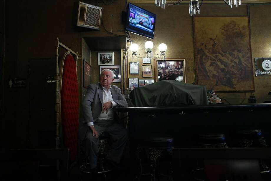 Gold Dust owner, Tasios Bovis, keeps quiet watch on the bar from the back of the Gold Dust Lounge on Feb. 9, 2012, in San Francisco, Calif.   Last December the owners of the Gold Dust lounge, at 247 Powell Street, received a notice from their landlord, the Handlery Hotel, to be out in 90 days to make way for new retail. After nearly 47 years running the bar, the Bovis brothers are not ready to go without a fight. Photo: Mike Kepka