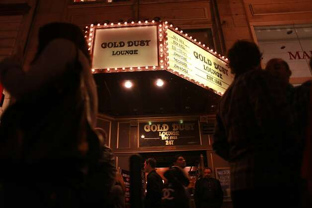 The kiosk at the Gold Dust Lounge lights up Powell Street in February.   Last December the owners of the Gold Dust lounge, at 247 Powell Street, received a notice from their landlord to vacate. After a legal fight, the owners closed up on Powell and are moving to Fisherman's Wharf. Photo: Mike Kepka