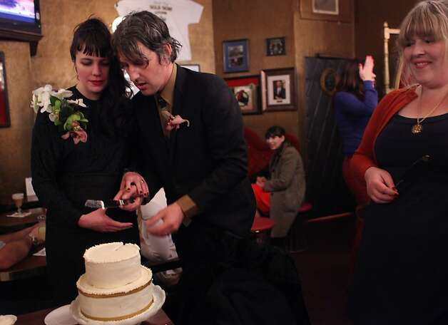 Michelle and Josh Haynes celebrate their wedding reception at the Gold Dust Lounge on Feb. 17, 2012 in San Francisco, Calif.   Last December the owners of the Gold Dust lounge, at 247 Powell Street, received a notice from their landlord, the Handlery Hotel, to be out in 90 days to make way for new retail. After nearly 47 years running the bar, the Bovis brothers are not ready to go without a fight. Photo: Mike Kepka