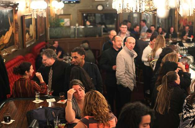 Crowds build on a Friday night at the Gold Dust Lounge on Feb. 10,  2012 in San Francisco, Calif.   Last December the owners of the Gold Dust lounge, at 247 Powell Street, received a notice from their landlord, the Handlery Hotel, to be out in 90 days to make way for new retail. After nearly 47 years running the bar, the Bovis brothers are not ready to go without a fight. Photo: Mike Kepka