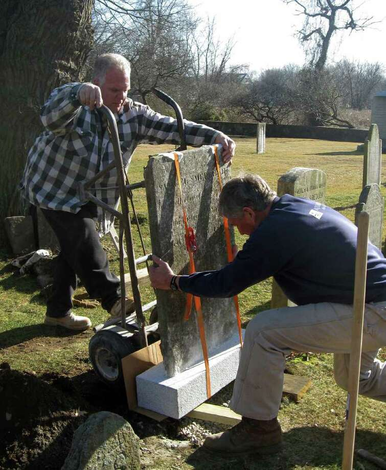 The repaired headstone for Capt. Samuel Smedley it put back in place at the Old Burying Ground on Beach Road recently. Photo: Contributed Photo / Fairfield Citizen