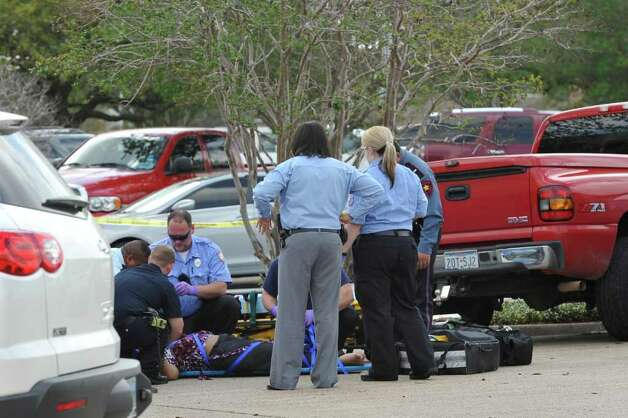 A suspected gunman held police at bay after he allegedly killed one person and injured several others in a shooting at the Jefferson County courthouse in downtown Beaumont late Wednesday morning. The shooting happened about 11:20 a.m. at the Jefferson County Courthouse in the 1000 block of Pearl about 11:20 a.m., according to the Beaumont Police Department.  This is one of the victims that was shot and being treated in the courthouse parking lot.   Dave Ryan/The Enterprise