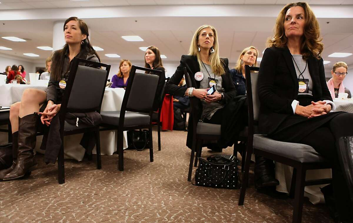 Christa Grenawalt (left) from Sausalito, Ellen Miner (middle) from Dwell Media in San Francisco, and Sara Terrien (right) from Mill Valley listening to the keynote speakers at the Exceptional Women in Publishing conference in San Francisco Calif., on Wednesday, March 7, 2012.