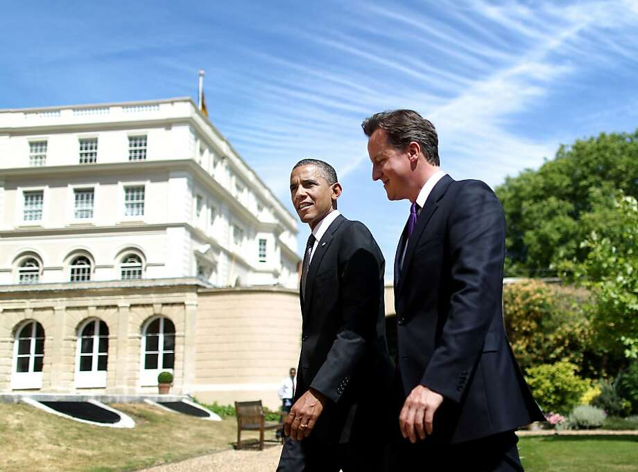 LONDON, ENGLAND - MAY 25: (FILE PHOTO)  On March 13, 2012 British Prime Minister David Cameron will meet U.S. President Barack Obama for a two day visit to Washington D.C. During his visit they will discuss Afghanistan, the Middle East and the global economy. President Obama will also talk about his hosting of the NATO and G8 summits in Chicago in May. The two countries share a close political, cultural and economic relationship.   Please refer to the following profile on Getty Images Archival for further imagery. http://www.gettyimages.co.uk/Search/Search.aspx?EventId=138529465&EditorialProduct=Archival&esource=maplinARC_uki_mar12  British Prime Minister David Cameron (R) and US President Barack Obama walk in the gardens of Lancaster House after holding a joint press conference on May 25, 2011 in London, England. The 44th President of the United States Barack Obama and First Lady Michelle Obama are in the UK for a two day State Visit at the invitation of HM Queen Elizabeth II. Last night they attended a state banquet at Buckingham Palace and today's events include talks at Downing Street and the President will address both houses of Parliament at Westminster Hall.  (Photo by Peter Macdiarmid - WPA Pool/Getty Images) Photo: Peter Macdiarmid, Getty Images