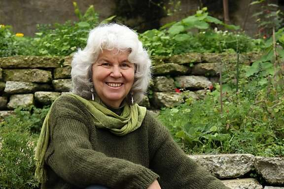 Pam Pierce, horticulturist and author of Golden Gate Gardening: The Complete Guide to Year-Round Food Gardening in the San Francisco Bay Area and Coastal California, sits in her back yard garden Friday, January 15, 2010.