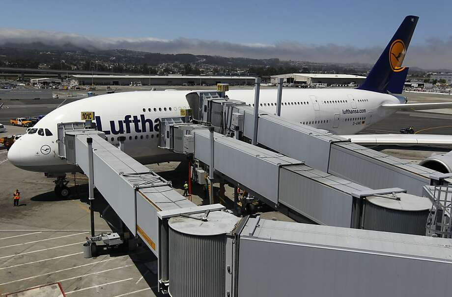 Three jetways are used to off-load passengers of a Lufthansa Airbus A380 super jumbo jet, the world's largest passenger aircraft, after its arrival at SFO on Tuesday after a flight from Frankfurt, Germany. Photo: Paul Chinn, The Chronicle