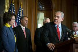WASHINGTON, DC - MARCH 6, 2012:   Israeli Prime Minister Benjamin Netanyahu (2nd R) speaks as U.S. House Minority Leader Nancy Pelosi (D-CA) (L) and Speaker of the House John Boehner (2nd L) look on at a press conference during a meeting in the U.S. Capitol building March 6, 2012  in Washington, DC. Netanyahu met with U.S. President Barack Obama yesterday with Obama pledging his support for Israel in dealing with potential Iranian nuclear arms, but expressed a desire for diplomacy in this effort.   (Photo by Allison Shelley/Getty Images)