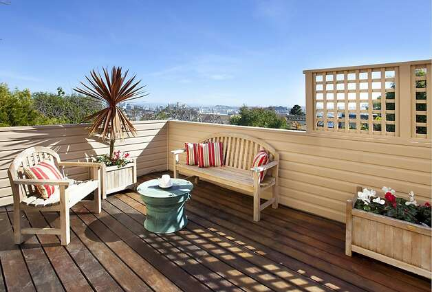 Providing city views, a deck is located on the upper level off the family room. Photo: Reflex Imaging