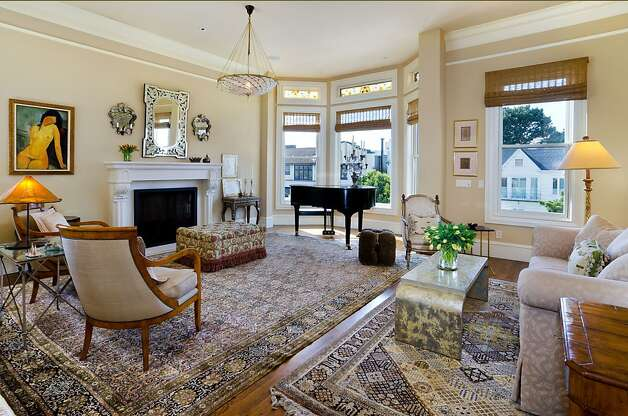 Natural light from large windows brightens the living room, which also has a fireplace. Photo: Reflex Imaging