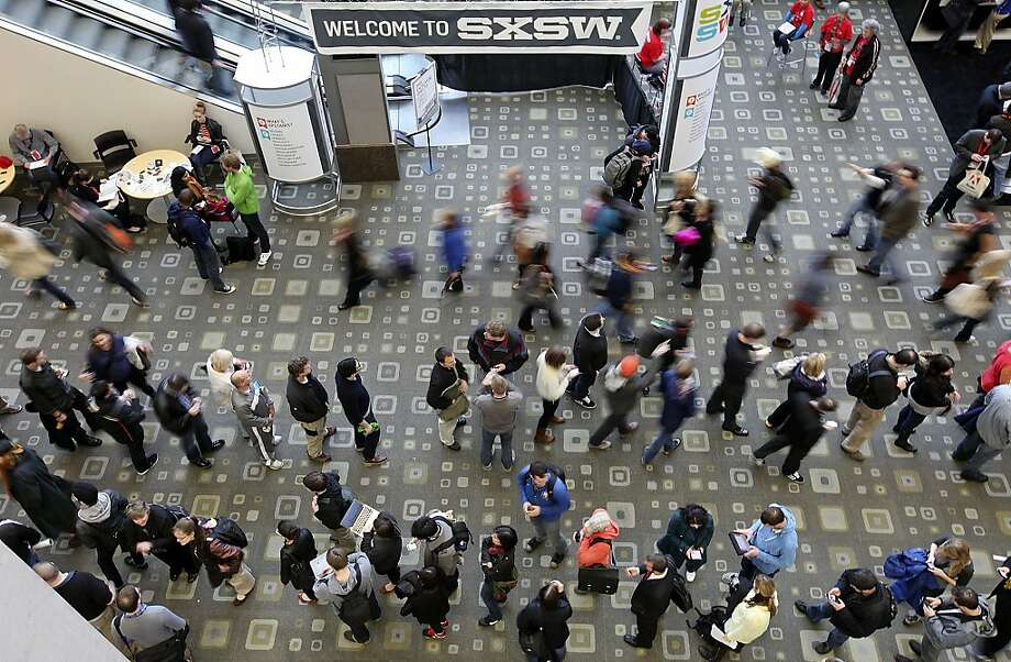 FOR METRO - People attending South by Southwest form a line to register for the festival Friday March 9,  2012 at the Austin Convention Center in Austin, TX. (PHOTO BY EDWARD A. ORNELAS/SAN ANTONIO EXPRESS-NEWS) Photo: Edward A. Ornelas, SAN ANTONIO EXPRESS-NEWS