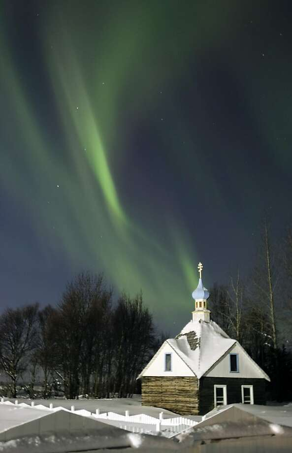 The northern lights or aurora borealis fill the western sky Friday, March 9, 2012, above the Russian Orthodox Saint Nicholas Memorial Chapel in Kenai, Alaska. The display of lights came in the aftermath of a solar storm that struck Earth on Thursday.  (AP Photo/Peninsula Clarion, M. Scott Moon) MAGS OUT, NO SALES Photo: M. Scott Moon, Associated Press
