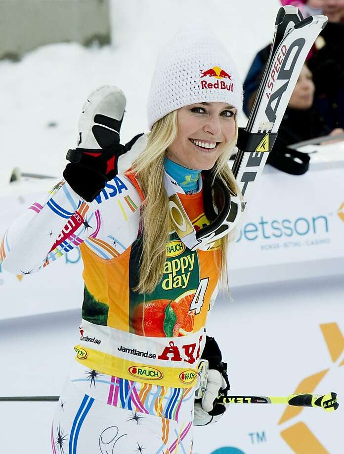 US' s Lindsey Vonn reacts as she finishes the second run of the FIS Alpine Ski World Cup women's giant slalom in Are, Sweden, on March 9, 2012.  Lindsey Vonn of the United States clinched the fourth overall women's alpine skiing World Cup title of her career after winning the giant slalom. It was the American ski queen's tenth win of the season - and 52nd of her career - and it gave her an unassailable lead over Slovenia's Tina Maze with five races still to go before the season finishes. AFP PHOTO/JONATHAN NACKSTRAND (Photo credit should read JONATHAN NACKSTRAND/AFP/Getty Images) Photo: Jonathan Nackstrand, AFP/Getty Images