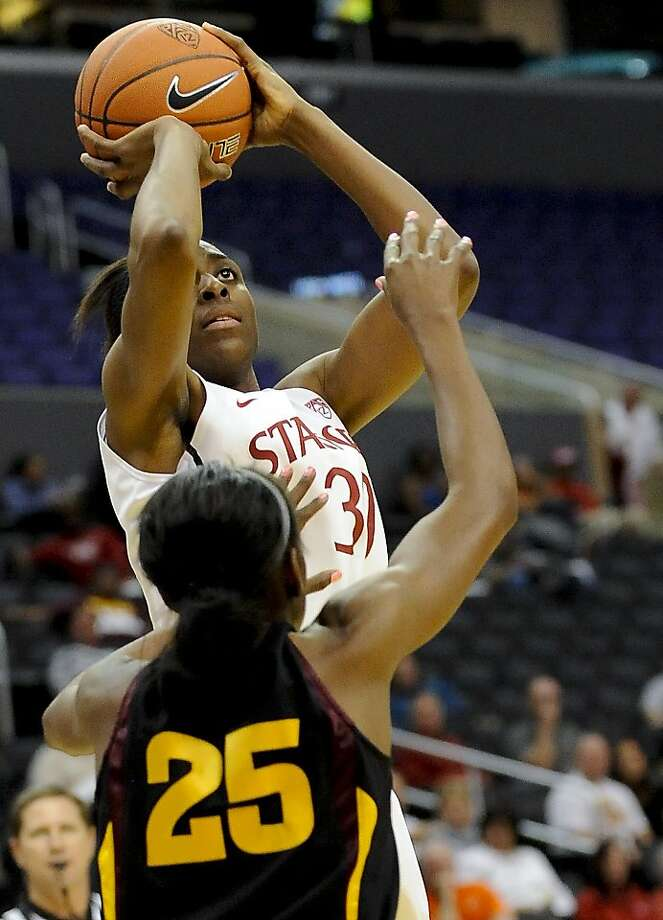 Stanford forward Nnemkadi Ogwumike (30) shoots for a basket over Arizona State forward Kimberly Brandon (25) during the second half of the NCAA college semifinals Pac-12 Conference tournament basketball game, Friday, March 9, 2012, in Los Angeles. Stanford won 52-43. Photo: Gus Ruelas, Associated Press