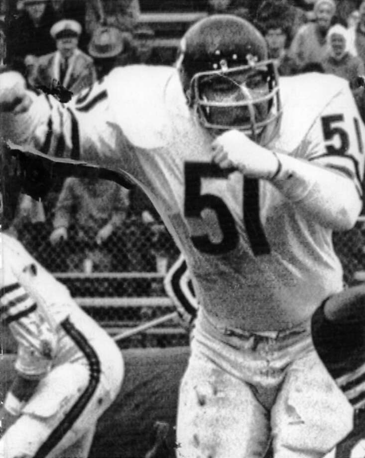 Chicago Bears middle linebacker Dick Butkus (51) decks 49ers back Bob Harrison (54) to help spring Bears fleet running back Gayle Sayers (40) on 97-yard touchdown run of the opening kick off Sunday. Later Sayers returned a punt for a TD. Chicago ended up Photo: Afdad, SFC